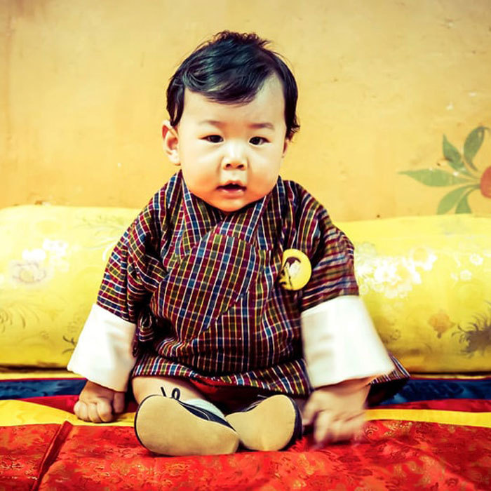 <p>The little Prince looked adorable wearing a traditional Bhutanese robe and little shoes.</p>