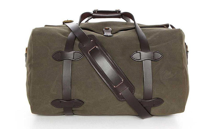 "<p><strong>Filson Small Duffel Bag</strong>, $440, <a href=""http://eastdane.com"" target=""_blank""><em>eastdane.com</em></a></p>"