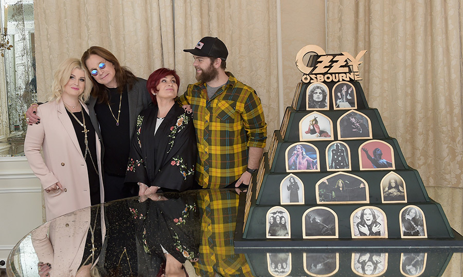 This just in! Ozzy Osbourne has just announced he'll be embarking on one last world tour - a final farewell to his music career, which will live on in history. Kelly, Ozzy, Sharon and Jack (who just welcomed his third baby) posed beside a photographic shrine of his long, fruitful career in music.