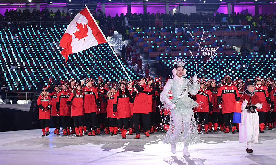 The Canadian flag bearers were beaming with excitement while opening the games.