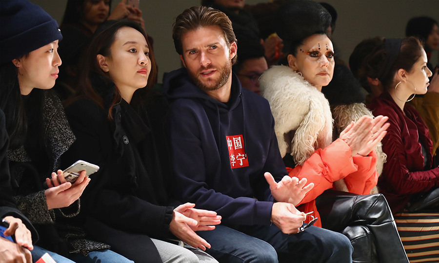 Actor Scott Eastwood chatted in the front row of the  Li-Ning Fall/Winter 2018 Collection show.