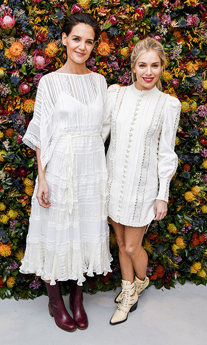 Katie Holmes and Sienna Miller were beautifully matching in white for Tory Burch's spring-themed runway.