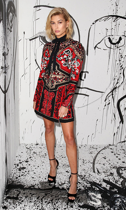 Talk about making a statement! Supermodel Hailey Baldwin stroke a pose in a stunning red embroidered dress during fashion week in the Big Apple.
