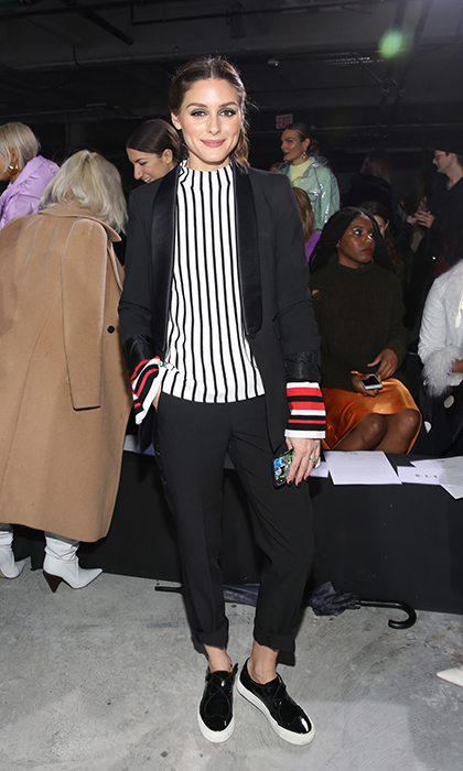 Olivia Palermo always gives us major wardrobe envy. The fashion maven stunned in a pinstripe top and modern blazer while at the Tibi show.