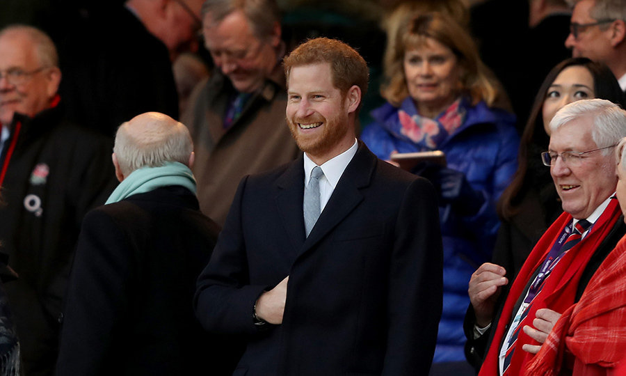 What a smile! Prince Harry took in a game of rugby on Feb. 10.