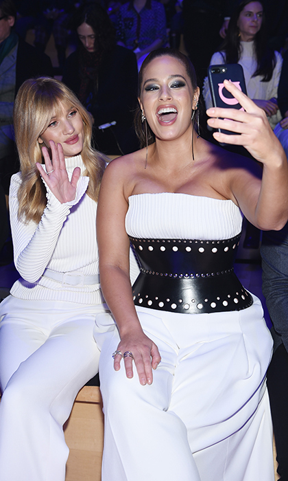 Models Rosie Huntington-Whiteley and Ashley Graham looked gorgeous in white sitting front row of the Brandon Maxwell show.