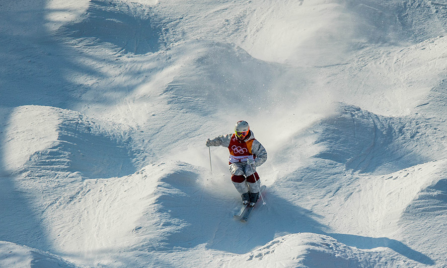 Mogul skier Mikael Kingsbury warmed up during a training session before his run and taking home the gold.