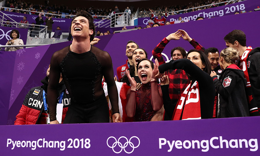 Ice dancing stars Scott Moir and Tessa Virtue celebrated their gold medal win on the sidelines after a stunning display of artistry on ice.