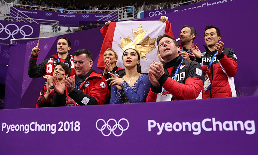 Gabrielle Daleman and her team awaited the final results of her skate.