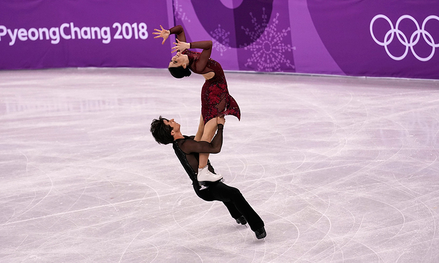 The crowd erupted with cheers and applause as Tessa Virtue perched on top of Scott Moir's legs.