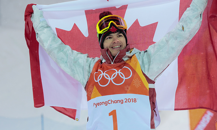 Gold medalist Mikael Kingsbury held up his Canadian flag with pride.