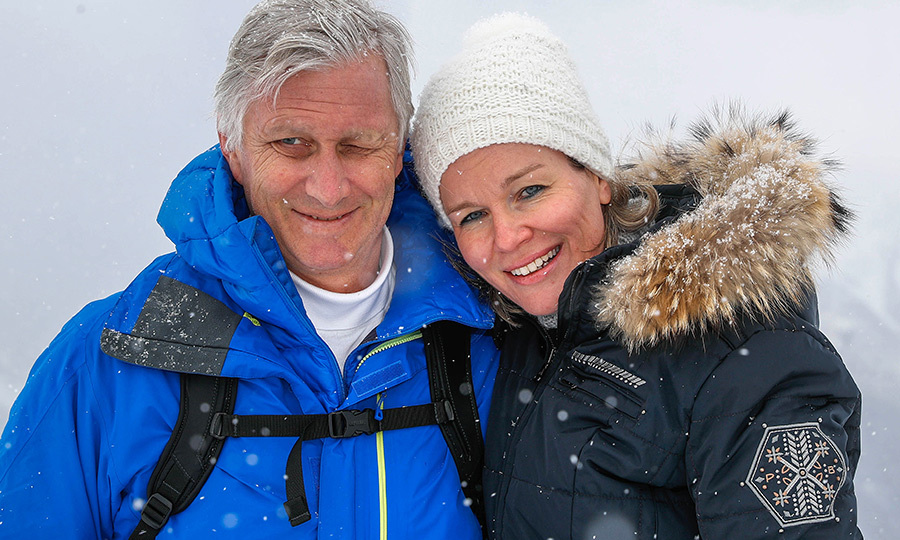 King Philippe and Queen Mathilde of Belgium stopped for a snowy photo during their family's holidays in Switzerland on Feb. 12.