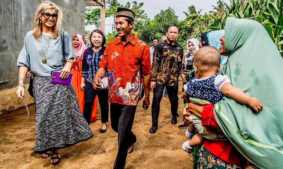 Queen Maxima smiled at an adorable baby while walking through corn fields in Indonesia on Feb. 12. 