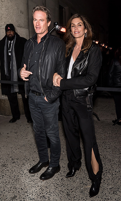 Rande Gerber and Cindy Crawford looked biker chic as they arrived at the NYFW Calvin Klein show - which Kaia Gerber walked in! - on Feb. 13.