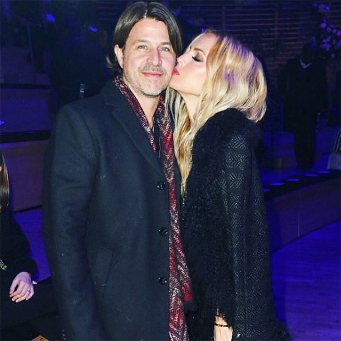 Rachel Zoe placed a smooch on her husbands cheek!
