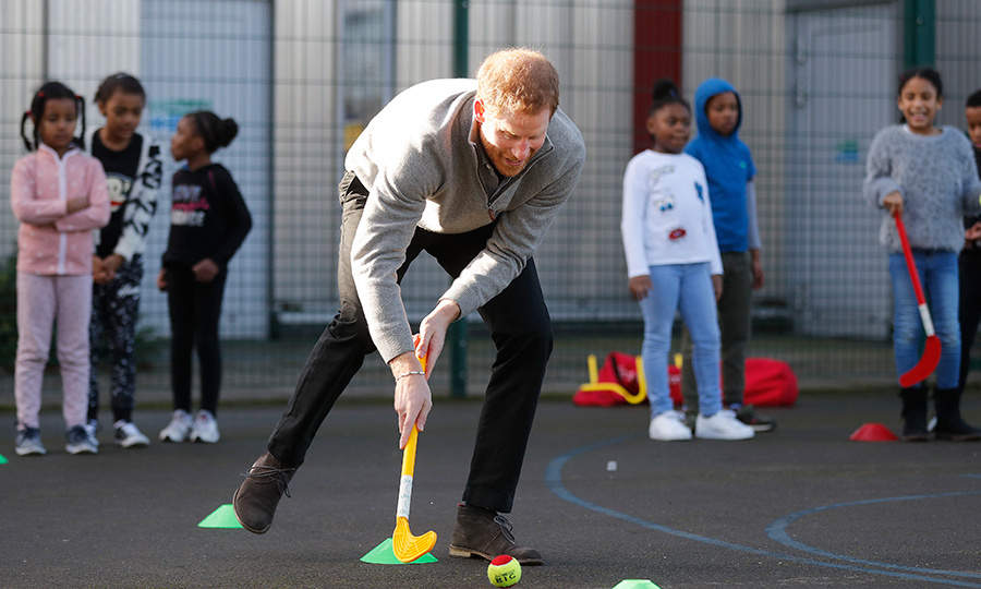 Prince Harry showed off some hockey skills during a visit to Fit and Fed - a holiday school program - at Roundwood Youth Centre on Feb. 15. 