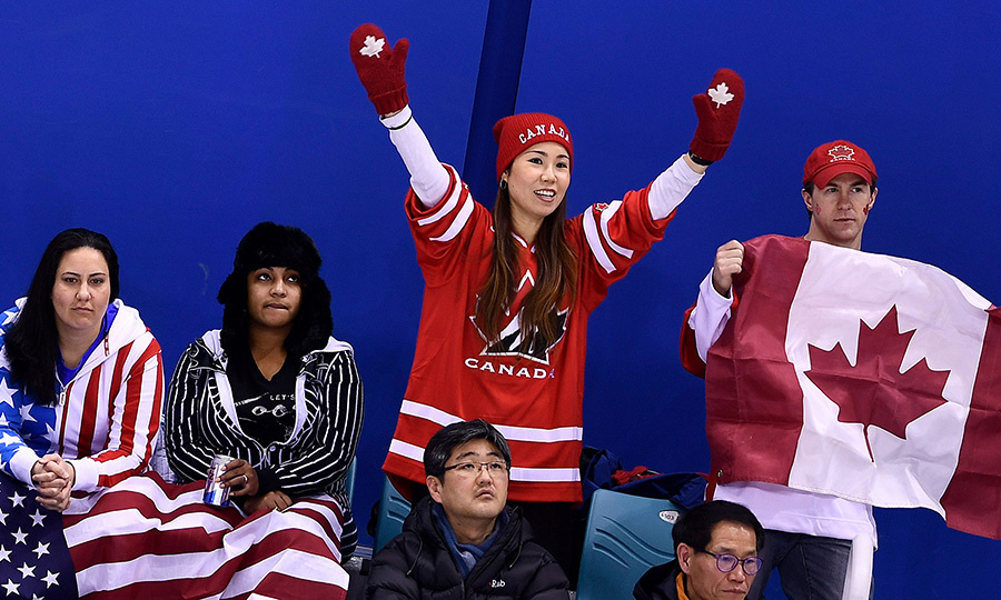 Canada defeated USA 2-1 last night during the women's qualifying hockey game! American fans weren't too impressed as Canadian fans cheered beside them.