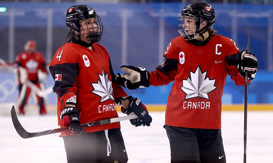 Brigette Lacquette chatted with her teammate Marie-Philip Poulin during the game. Brigette is the only First Nations women to ever play on the Olympic women's hockey team.