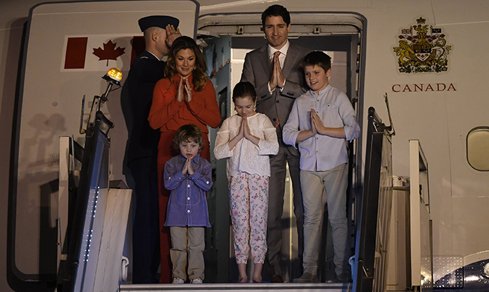 "Namaste! Justin Trudeau and his wife Sophie Grégoire Trudeau kicked off a week-long tour of India with their kids with a traditional bow as they disembarked in New Delhi on Saturday, Feb. 17. ""Wheels up for India and a busy visit, focused on creating good jobs and strengthening the deep connection between the people of our two countries,"" he said on Twitter. The Prime Minister and his family will visit a number of popular sites in addition to his participation in meetings and round tables focussed on human rights and education. Here, we round up the best photos from their state visit...