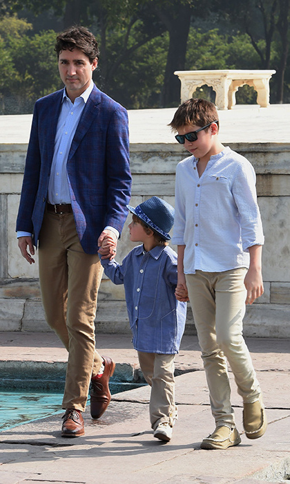 Looking cool in khaki and blue, Justin and his sons strolled through the Taj Mahal grounds holding hands.