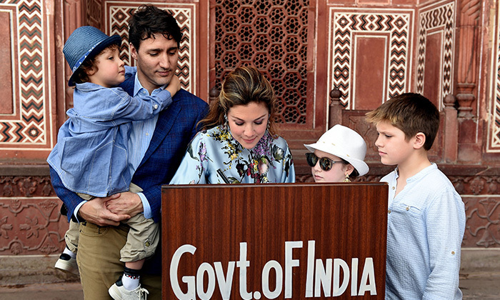 Sophie signed the visitor's book at the Taj Mahal in Agra while her family looked on. 