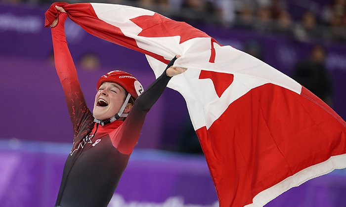 Victory! Kim Boutin celebrated her bronze medal for short track speed skating.