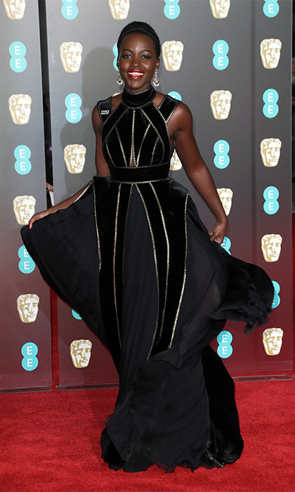 Lupita Nyong'o showcased her trademark statement style perfectly in a shimmer gown that featured a fabulously eye-catching design which consisted of vertical stripes that ensured she stood out from the crowd! The centre of the dress even featured an applique, 3D peplum by Elie Saab Couture.