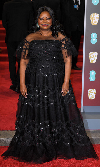 Octavia Spencer stunned on the red carpet in a beautifully cut gown which featured an abundance of exquisite lace detail, a smattering of sequins and decadent tulle sleeves to gave it an extra special edge. She accessorized her outfit with diamond earrings and a cocktail ring.