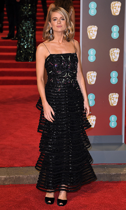 Prince Harry's former girlfriend Cressida Bonas was a sight for sore eyes in a  unique yet totally chic dress that hugged her lithe frame. The pretty dress featured decadent tiers which gave it a stunningly contemporary look. Her mid-length blonde locks were teased into loose curls and glowing makeup completed her appearance.