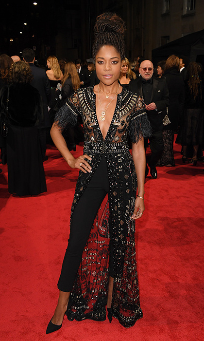 Naomie Harris decided to leave a dress at home, instead opting for smart black tailored trousers and a stunning beaded creation which sat perfectly over the top! The abundance of beads, gems and sequins gave her outfit a distinctive edge. She wore her hair in a gorgeous up do.