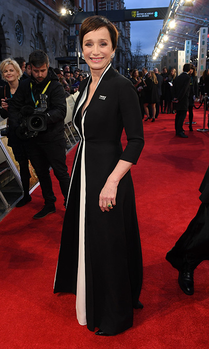 Kristin Scott Thomas wore a black tunic dress which featured bold white piping and was cut in a super smart, tailored style which finished into a 'V' neckline. The 57-year-old wore it over a pair of black trousers, chic high heel shoes and accessorised with an abundance of sparkling statement diamonds.