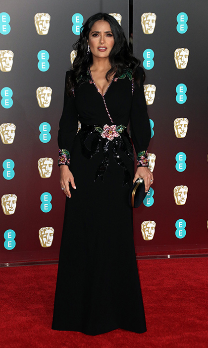 Salma Hayek looked beyond gorgeous in one of her favourite designers – Gucci. The close-fitting number hugged her sensational curves and also boasted trendy shoulder-pads. Beaded and jewel-encrusted floral detail was added at the waist and cuffs, jazzing up the black hued design subtly.