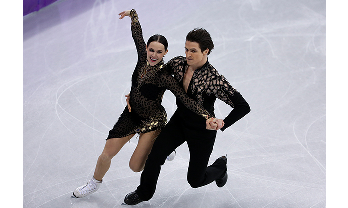 Though they have denied any romantic involvement, the 28-year-old and her 30-year-old partner were perfectly in sync as they danced across the ice to a record-breaking finale. 