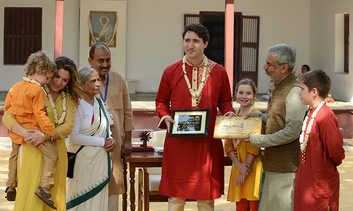 The Trudeau family posed with mementos from the ashram alongside Kartikeya Sarabhai, trustee of the Sabarmati Ashram Preservation and Memorial Trust; Elabehn Bhatt, chairperson of Sabarmati Gandhi Ashram Preservation and Memorial Trust; and Jayeshbhai Patel, one of the co-founders of the NGO Manav Sadhna. 