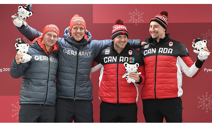 Canada's Justin Kripps and Alex Kopacz tied for gold with German competitors Francesco Friedrich and Thorsten Margis in the two-man bobsled event. It's the pair's first time on the podium.