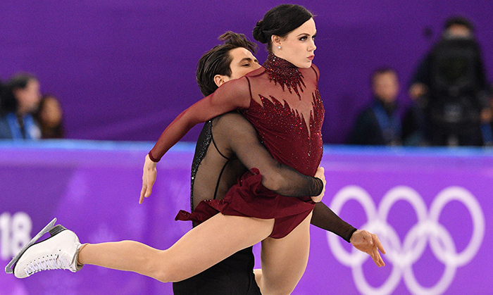 "And the crowd went wild! Canada exploded with pride as Tessa Virtue and Scott Moir earned their second Olympic gold medal in Pyeongchang on Feb. 19 following a fiery performance of ""Roxanne"" (and a Moulin Rouge medley), which broke the world record for the free skate event. 