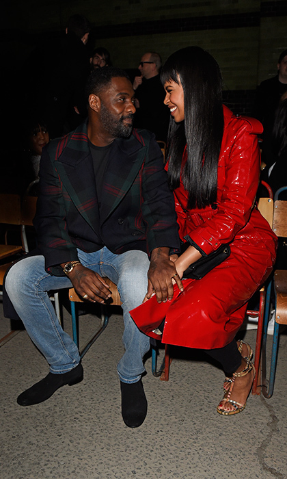 Idris Elba and his new fiancée Sabrina Dhowre were totally loved up at the star-studded Burberry show on Feb. 17. 