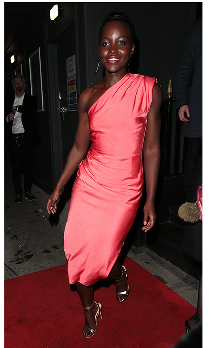 <em>Black Panther</em> star Lupita Nyong'o wore a bright one-shouldered dress to a party at MNKY HSE, a Latin American restaurant in Mayfair. 