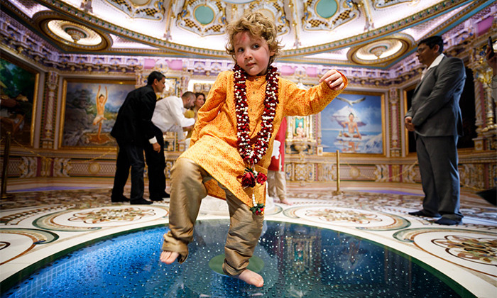 At the stunning Akshardham Temple, 3-year-old Hadrien found his sweet spot on a blue glass inlay as his family enjoyed a tour of the spiritual centre. 