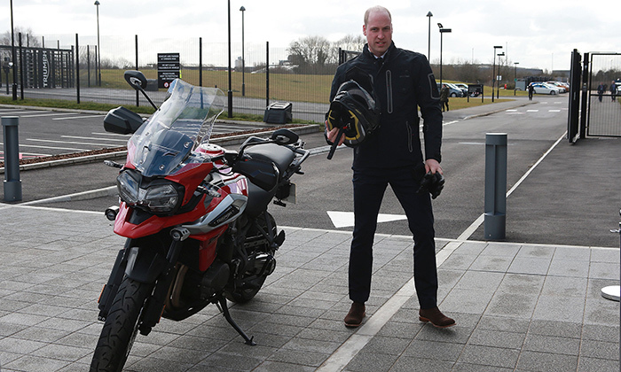 "Prince William says his biking hobby fills wife Kate with ""horror,"" but that didn't stop the cool dad from taking a motorcycle for a spin during his tour of the Triumph factory and assembly line, where he officially opened the new Visitor Experience.