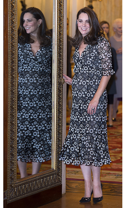 Looking fresh and poised at the Commonwealth Fashion Exchange reception at Buckingham Palace on Feb. 19, Kate donned a patterned dress by Canadian-born designer Erdem and elegant black pumps, accessorizing with a simple clutch bag and earrings by Anita Dongre. The glowing royal wore her beautiful rich locks in her trademark voluminous style, which was preened to perfection.