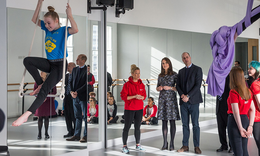 The royal couple watched a group of gravity defying aerial performers while at The Fire Station. Kate wore a floral dress by one of her favourite maternity brands, Seraphine, while William opted for slacks and a sports jacket.