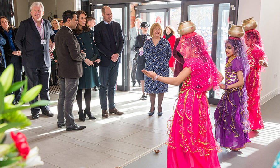 A group of young performers at The Fire Station treated Prince William and Kate to a dance while balancing gold pots on their heads. The arts and music hub engages young people in creative pursuits. 