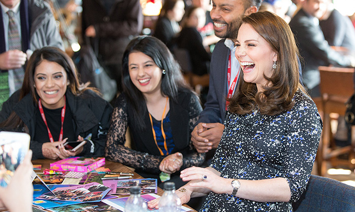 Kate was in high spirits as she chatted with staff and students at The Fire Station while her henna tattoo dried.