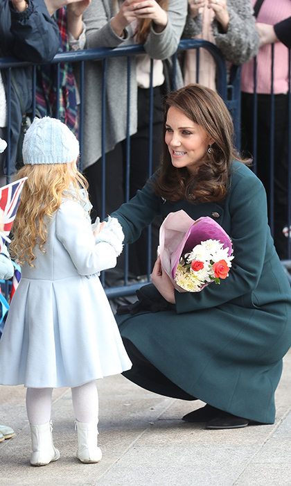 Kate was surely reminded of her adorable daughter Princess Charlotte when she chatted with a young fan outside the Fire Station.