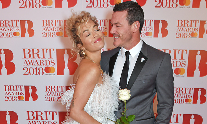 "Rita Ora and Luke Evans hammed it up for the cameras at the 2018 Brit Awards in London on Feb. 21. The ""For You"" singer performed the <em>Fifty Shades</em> duet with Liam Payne during the show while her actor pal presented.