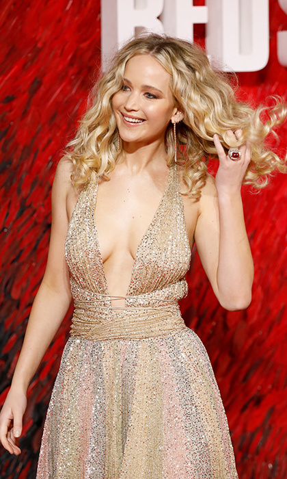 "Curly hair, don't care! Jennifer Lawrence was a golden girl at the London premiere of her new film <em>Red Sparrow</em>. She wore a stunning Dior couture gown with a plunging neckline. The actress recently revealed to Entertainment Tonight that she was so comfortable during her nude scenes on set that she didn't jump to put on a robe after the cameras stopped rolling. ""Everybody made me feel so comfortable that I probably at a certain point started making everybody else uncomfortable."" She plays a ballerina-turned-secret agent in the thriller.