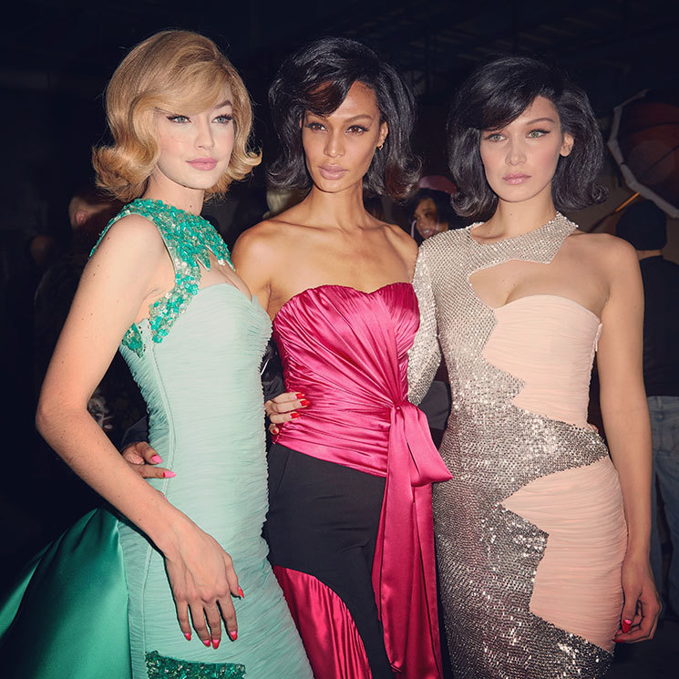 <p>During the Moschino fashion show, Joan Smalls cozied up backstage between the Hadid sisters for this <em>Mad Men</em>-esque group shot.</p>