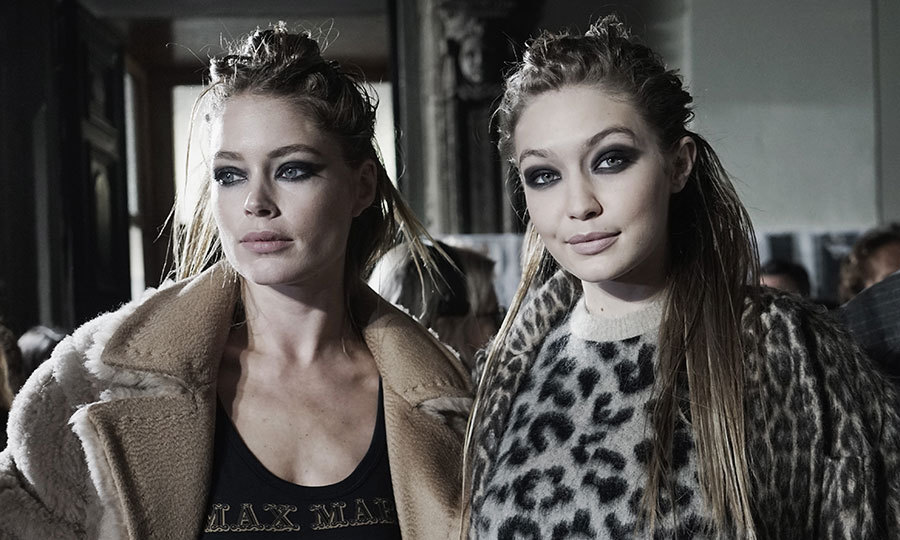 <p>Doutzen Kroes and Gigi Hadid looked fierce together backstage at Max Mara.</p>