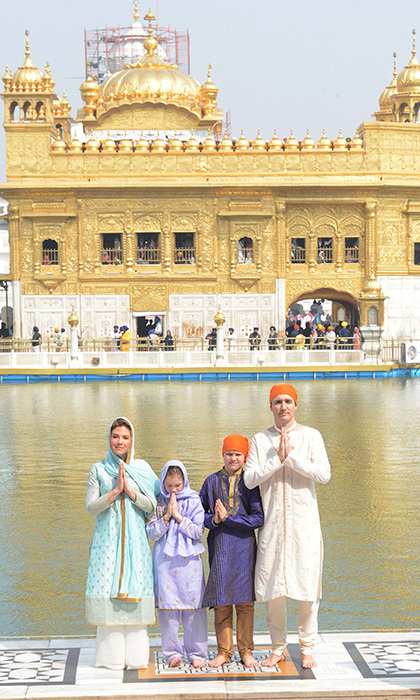 "Clad in colourful Indian attire, the Trudeaus visited the Golden Temple, a famous Sikh Shrine. Justin, Sophie, nine-year-old Ella-Grace and 10-year-old Xavier offered prayers inside the temple before learning how to make roti in the community kitchen. The Canadian Prime Minister signed the visitor's book, saying: ""What an honour to be so well received at such a beautiful, meaningful place. We are filled with grace and humility.""